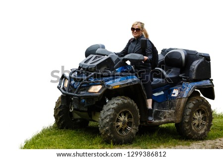 A happy woman riding a quad bike isolated, white, background Stock photo ©