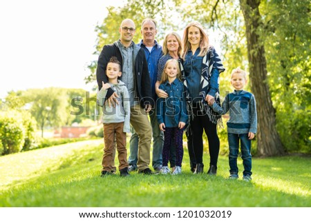 A Happy young family outside in green nature #1201032019