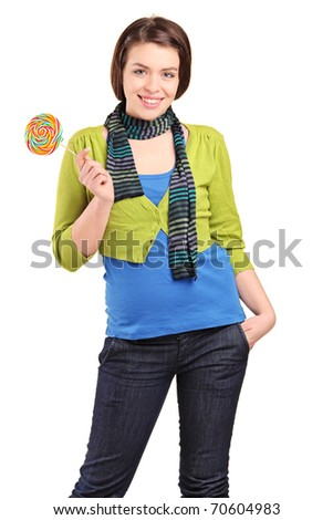 A happy young girl holding a lollypop isolated on white background