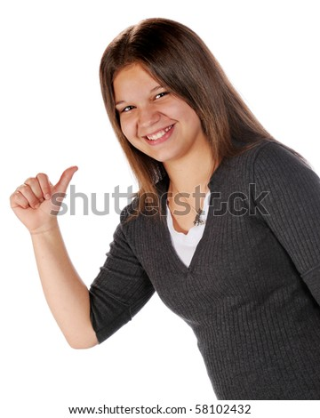 stock photo : A happy young teen pointing behind with her thumb.