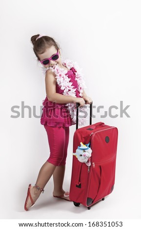 A happy young traveler with a red suitcase.