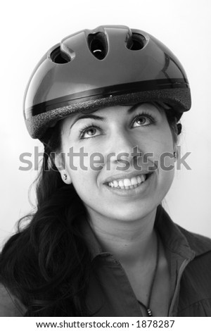 A happy young woman with a bicycle helmet looking up (black and white version) - See more in portfolio
