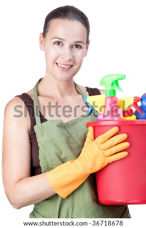 A happy young woman with cleaning equipment ready to clean - on white.