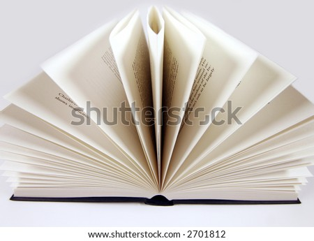 a hardback book with pages open wide