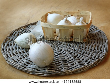 a harvest of white bow is in a basket