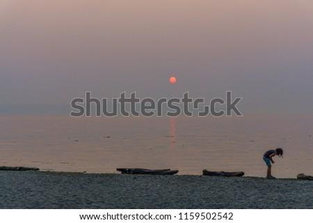 A hazy sunset in Burien, Washington.