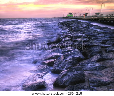 A HDR image of St. Kilda Beach (Australia) and Pier at twilight