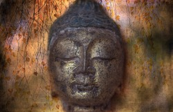 A head of antique Buddha statue on textured background