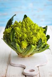 A head of Romanesco broccoli on on chopping board