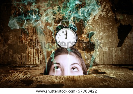 A head of the woman with an alarm clock in the thrown interior. Surrealistic composition.