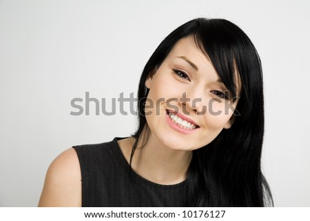 A headshot of a beautiful smiling businesswoman