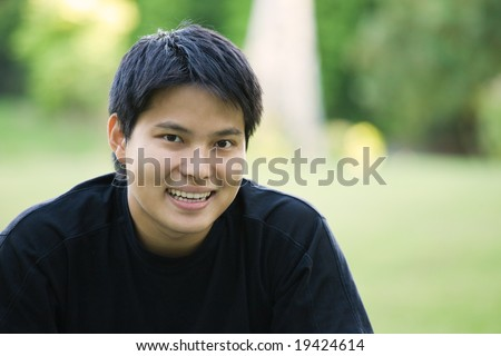 A headshot of an asian college student