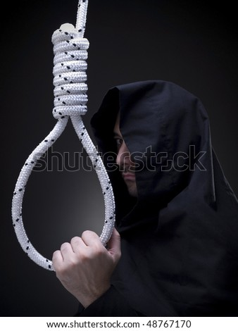 A headsman is looking askance to the camera while holding a noose.