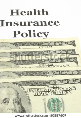 A health insurance policy with a stack of Ben Franklins or one hundred dollar bills.