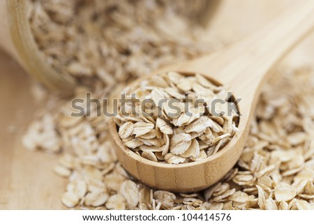 A Healthy Dry Oat meal in a wooden spoon