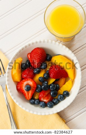 A healthy fresh fruit salad with strawberries, blueberries and nectarines is a delicious summer breakfast.