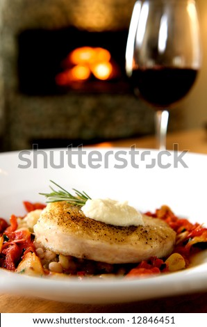 A healthy gourmet sworfish dinner complete with wine and fireplace