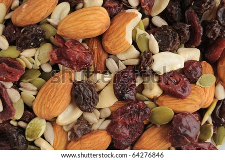 A healthy organic trail mix of almonds, raisins, cranberries, and other various nutrition. - stock photo