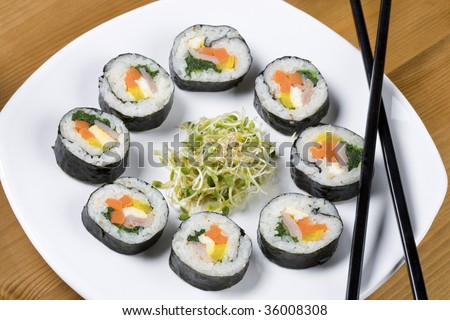 A healthy serving of KOrean style sushi called kimbap.