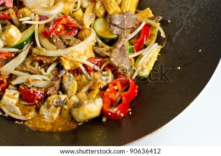 A healthy stir fry wok beef with vegetables.