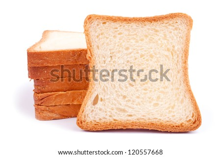 A heap of bread slices and one slice like a copy space, leaning on the heap - isolated on white