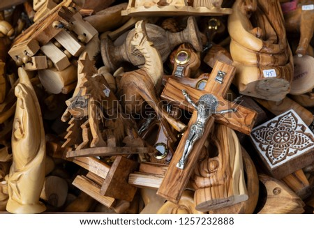 A heap of christmas souvenirs made mainly of olive wood, on display at a Nazareth marketplace