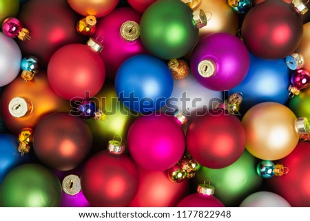 A heap of colorful christmas baubles lying on the floor. #1177822948
