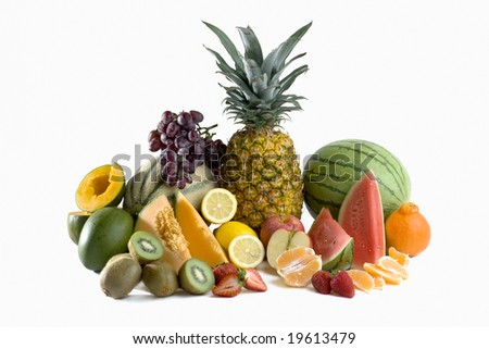 A heap of cut tropical fruits on a white background, very colorful image