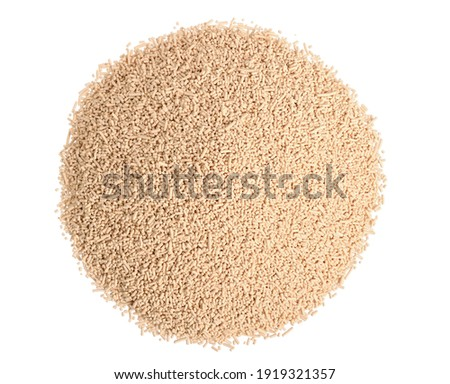 A Heap of Dry Baking (Bakers) Fast Acting Yeast Granules. Top View. Isolated on White. Stock fotó ©