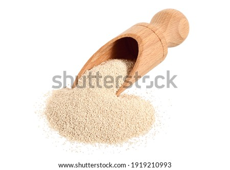 A Heap of Dry Baking (Bakers) Yeast Granules with a Scoop. Isolated on White. Stock fotó ©