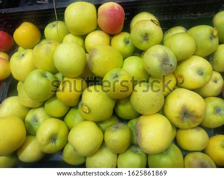 A heap of Freshly harvested , juicy golden apples