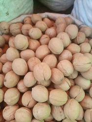 A heap of unbroken walnuts