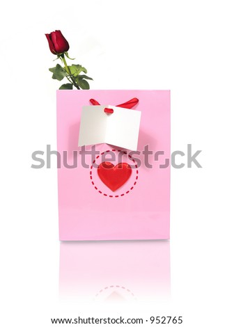 A heart decorated bag with rose and card