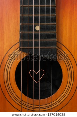 A heart lies on strings the guitar can be used as background
