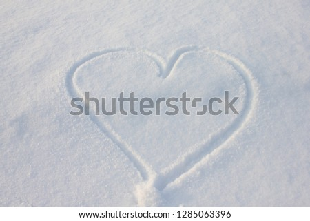 A heart made with hand in the snow #1285063396