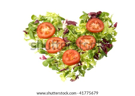 heart of tomatoes and green salad suggesting the ideas of love and ...