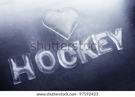 "A Heart shape and word ""hockey"" made of real ice."