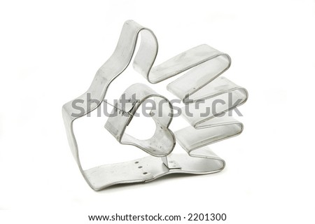 A heart within a hand cookie cutter isolated on a white background
