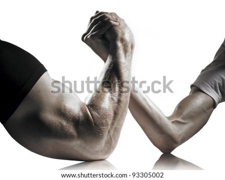 A heavily muscled man arm wrestling a puny weak man