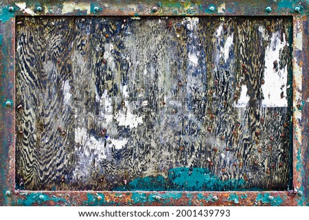 A heavily weathered and textured noticeboard Stock photo ©