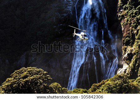 A helicopter flies over Fiordland, southern New Zealand.