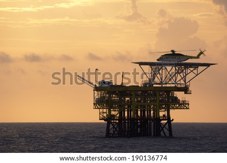 A helicopter on top of a offshore oil-platform for transporting roughnecks to nearby rigs