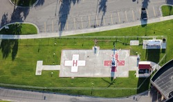 A helicopter pad for medical emergency flights to a modern hospital