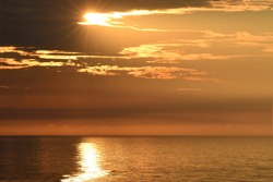 A high angle point of view from the balcony of an Atlantic city hotel captures the sun break the horizon and present with a beautiful sunrise off the Atlantic ocean.