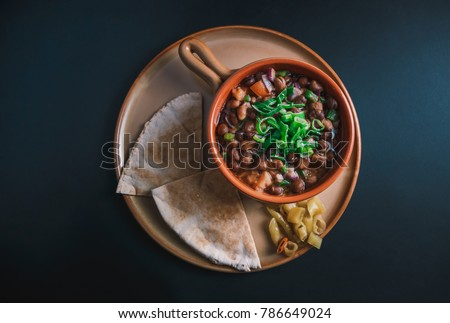 A high angle view/color studio image of Egyptian, Arabian, Middle Eastern Traditional food (Fava Beans with Vegetables/Green Paprika) A.K.A (Foul) - Also served in Lebanon and most of Arabian countrie #786649024