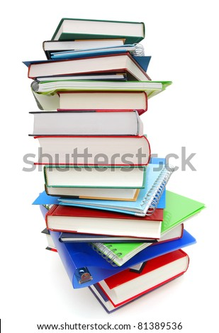 A high book pile in school - stock photo