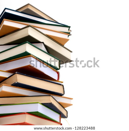 A high pile of books isolated white background