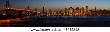 A high-resolution stitched image of Bay Bridge and San Francisco downtown in Christmas lighting (shot from Treasure Island).  Copyspace on top and bottom.