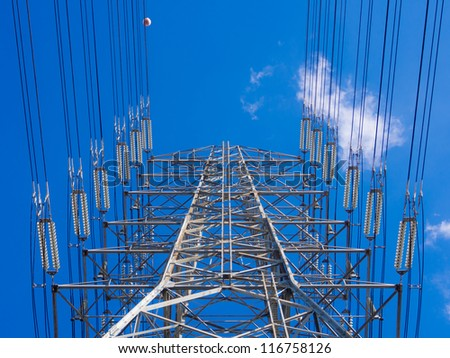 a high-voltage electricity pylons against blue sky