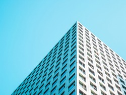 A highrise building against the blue sky